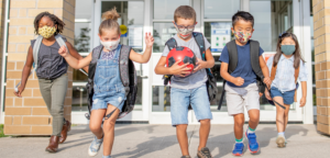 Masked children going back to school during the COVID 19 Pandemic